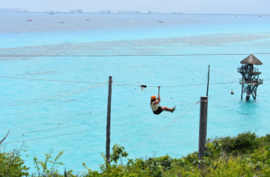 Zip lining over the Caribbean Sea is one of the main attractions at Garrafon Park.